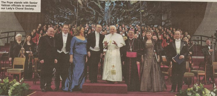 The  Pope stands with Senior Vatican officials to welcome Our Lady's Choral Society